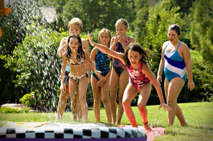 kids in sprinklers