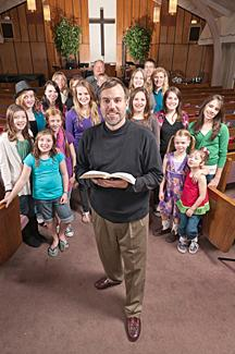 Pastor directing children