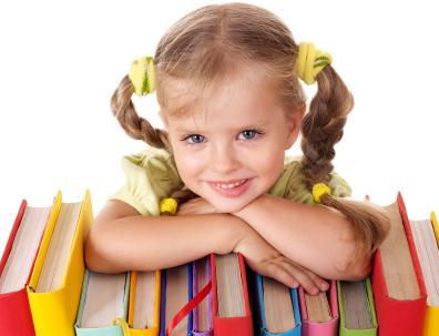 Little girl leaning on books