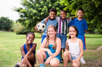 Group of kids with a soccer ball