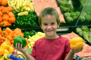 Kid holding vegetables