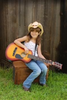 Kid country western musician