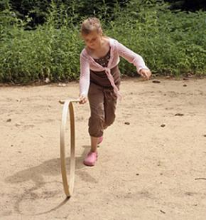 Girl playing hoop and sticks