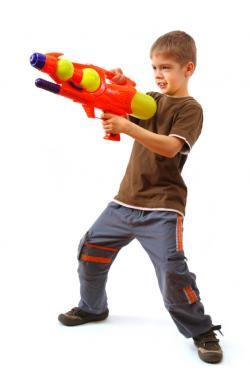boy with water blaster gun