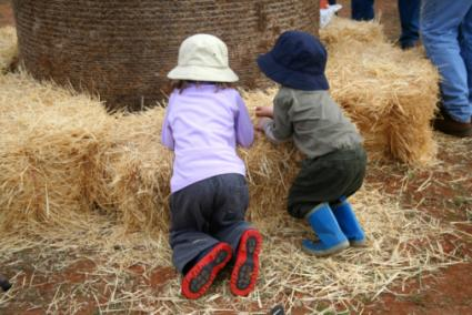 Kids playing in hay