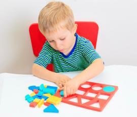 Little boy with shape puzzle