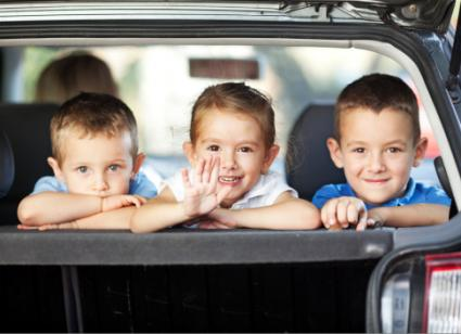 3 boys in a car