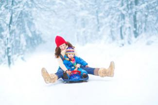 Mother and daughter sledding