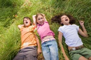 kids lying in grass