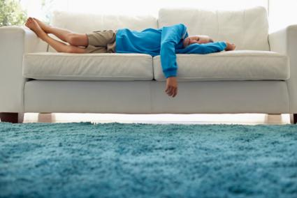 Boy Lying on Couch