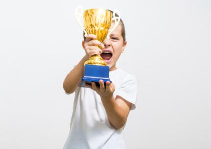 Boy celebrates his golden trophy