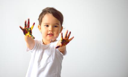 Little girl showing painted hands