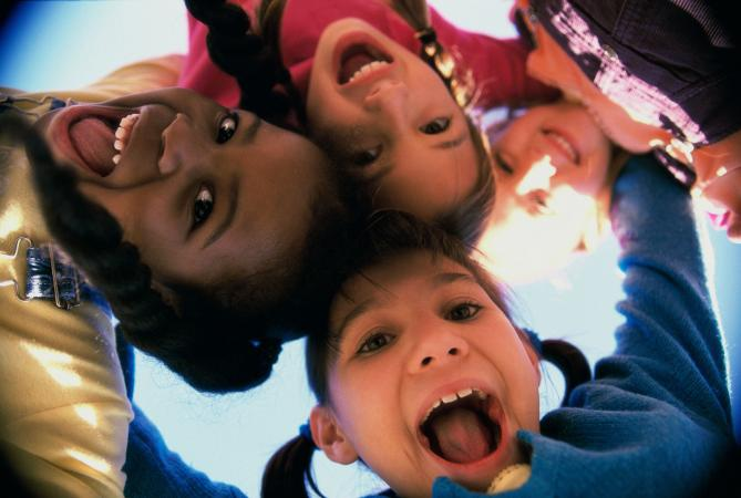 Children looking down at camera
