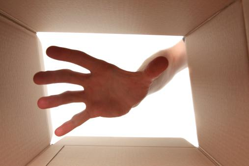 Hand reaching into box