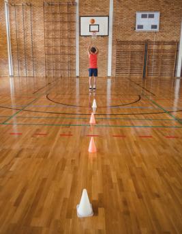 high school boy playing basketball