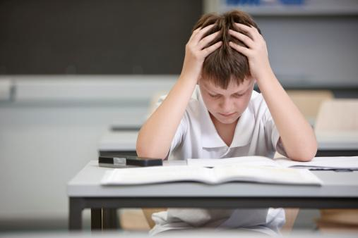 Schoolboy struggling in educational exam