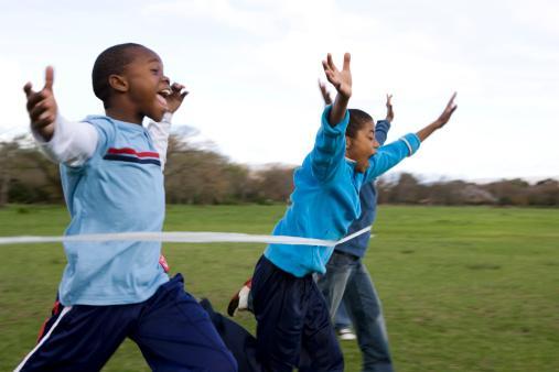 Boys running through finishing line