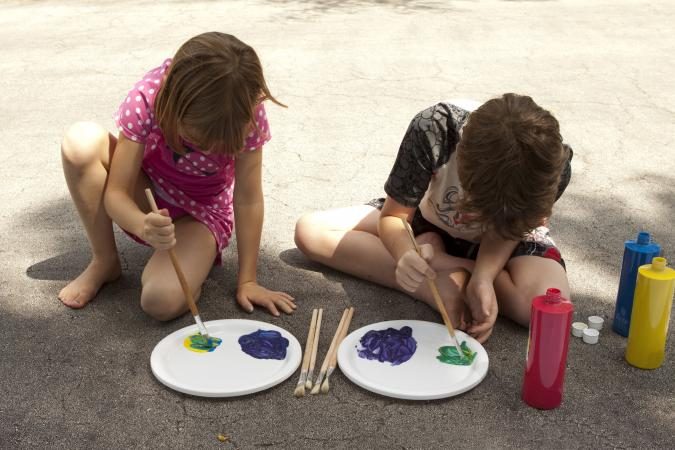 boy and girl painting together