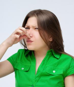 girl pinches her nose