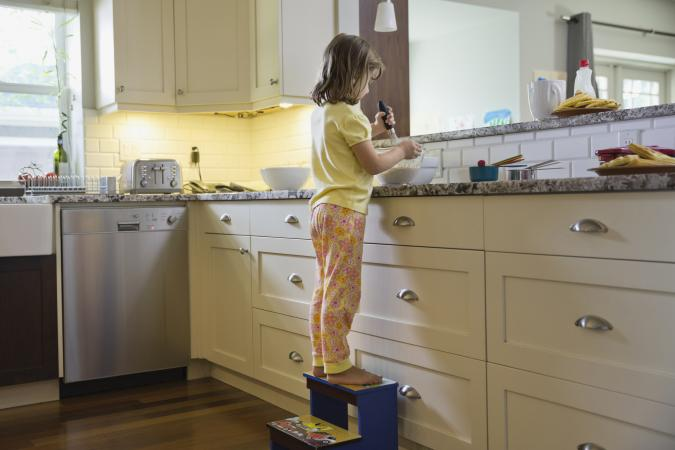 Little girl on step stool