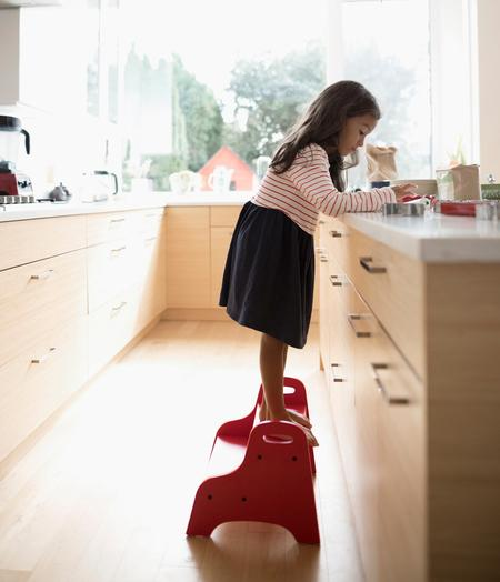 Girl on step stool