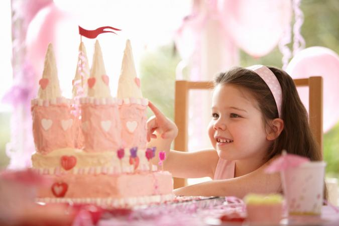 girl with princess castle birthday cake