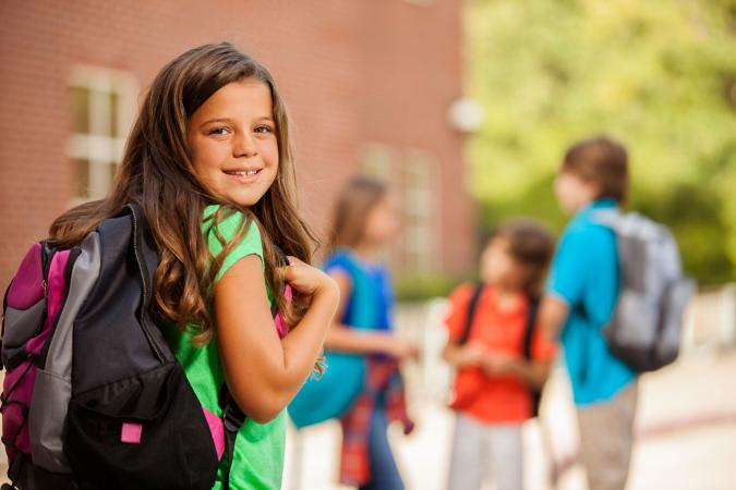 Girl with backpack at summer school