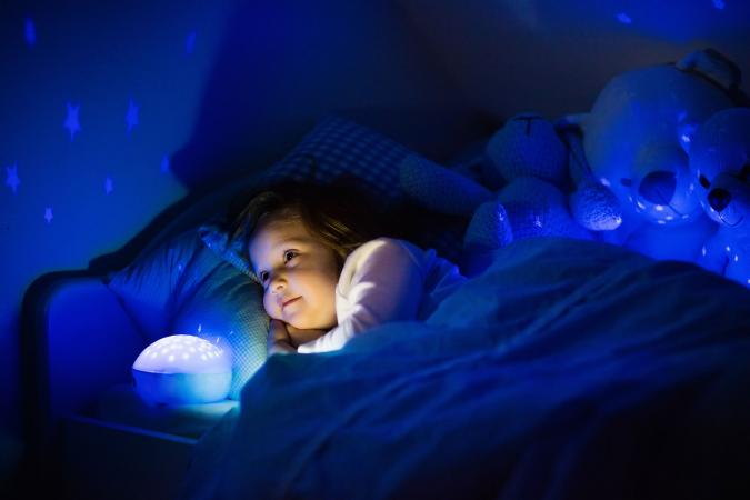 Girl watching star projection night light