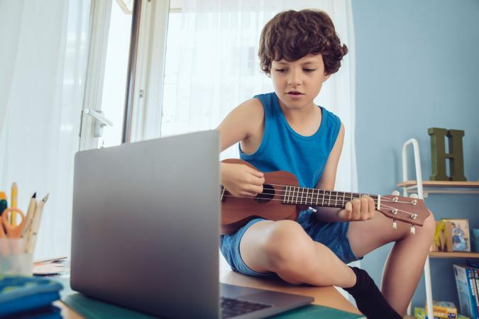 boy taking ukulele lesson online