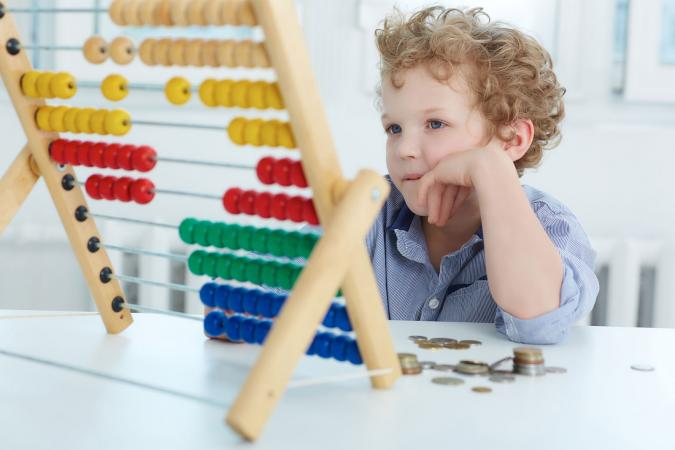 Boy learning to count change