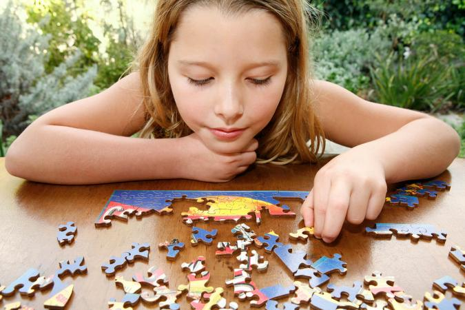 Girl doing puzzle