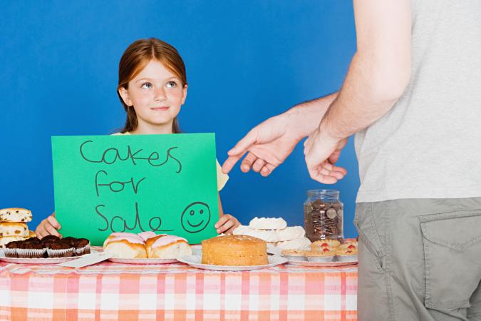 Girl selling cakes