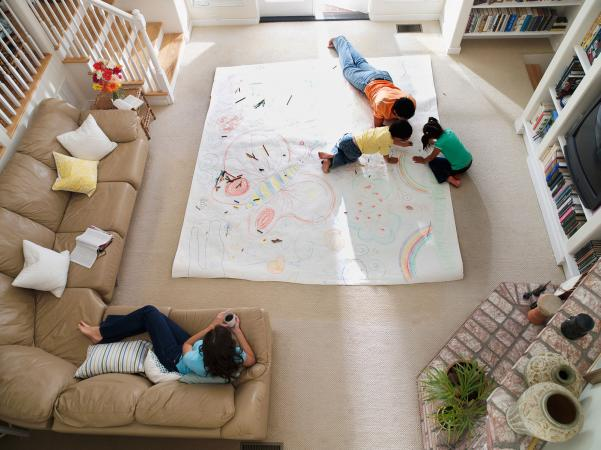 Kids drawing on large paper