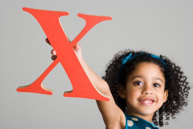Girl holding letter X
