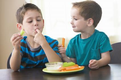 Kids eating vegetables and dip