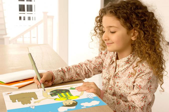 Girl coloring beach page at table