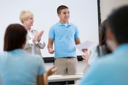 teenager giving speech in front of class