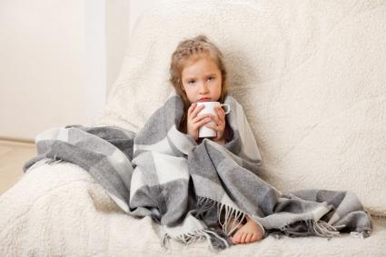 Girl not feeling well holding cup