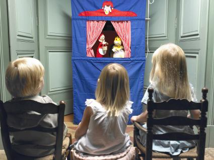 Kids watching a puppet show