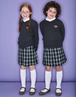 Two smiling girls wearing school uniform