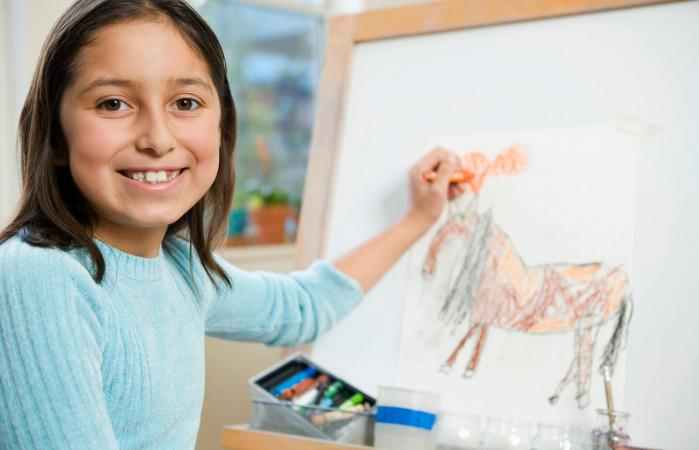 Schoolgirl drawing a horse