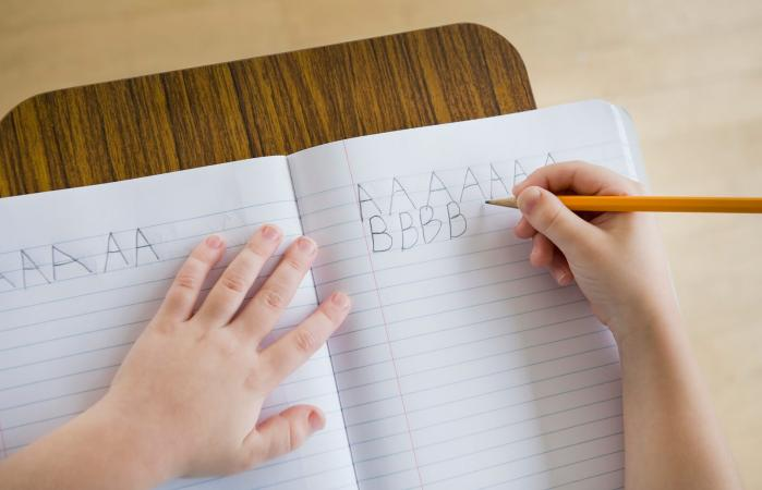 Boy writing letters