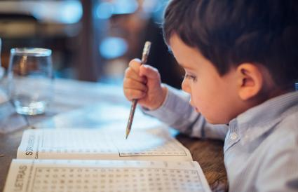kid making a wordsearch