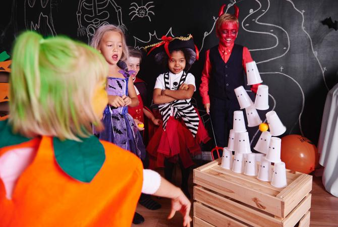 Kids playing a Halloween party game