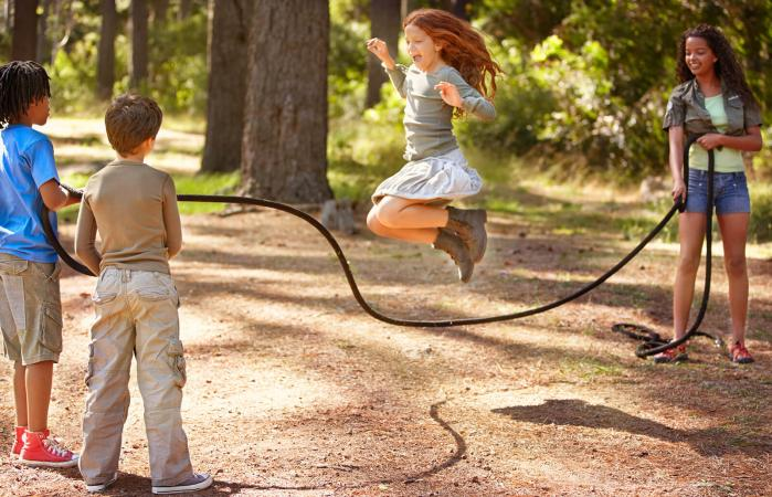 Kids play jump rope