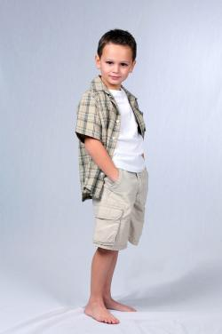 Young boy modeling clothes for catalog