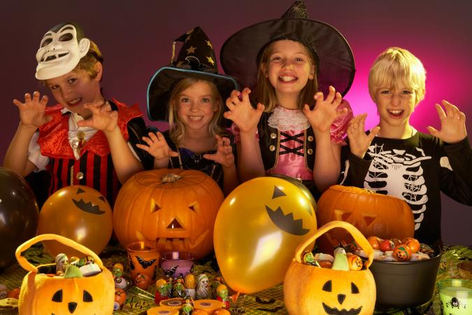 Kids in costume celebrating Halloween