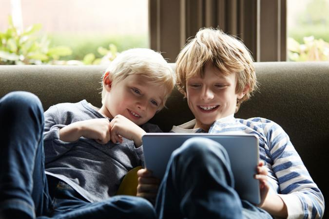 two boys playing Disney online games