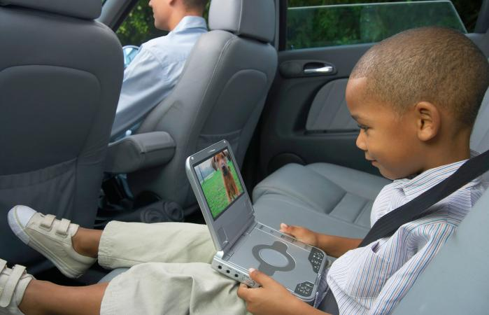 Boy using portable DVD player