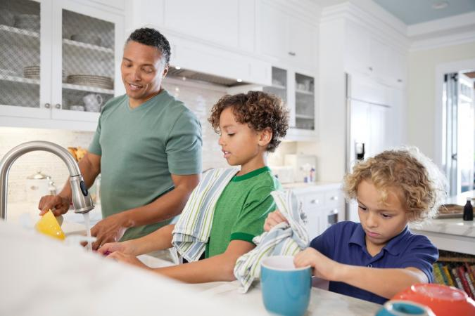 dad and boys doing dishes